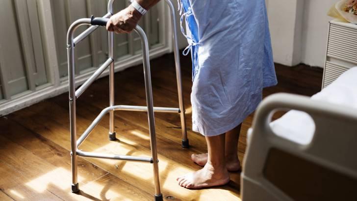 elderly patient in hospital gown
