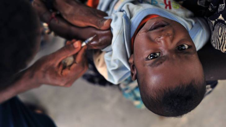 young child getting vaccinted