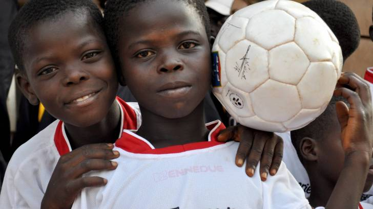 2 african boys playing soccer