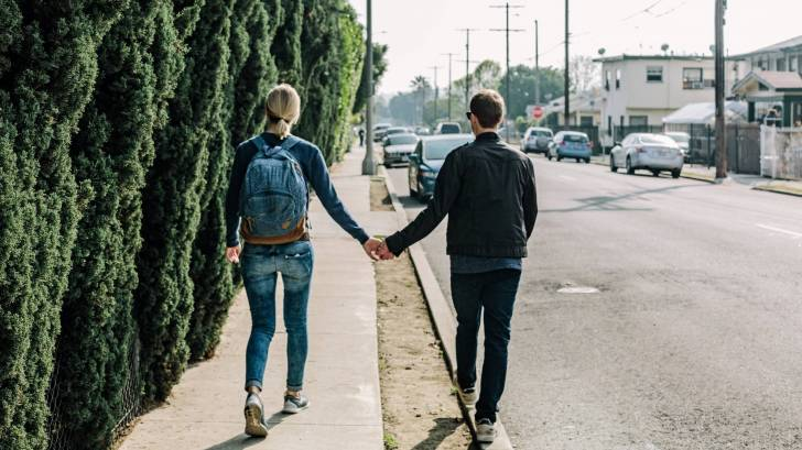 young couple alking along a street