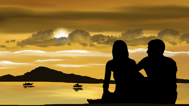 couple silhoutte against the sky and ocean
