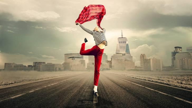 happy girl dancing in the street