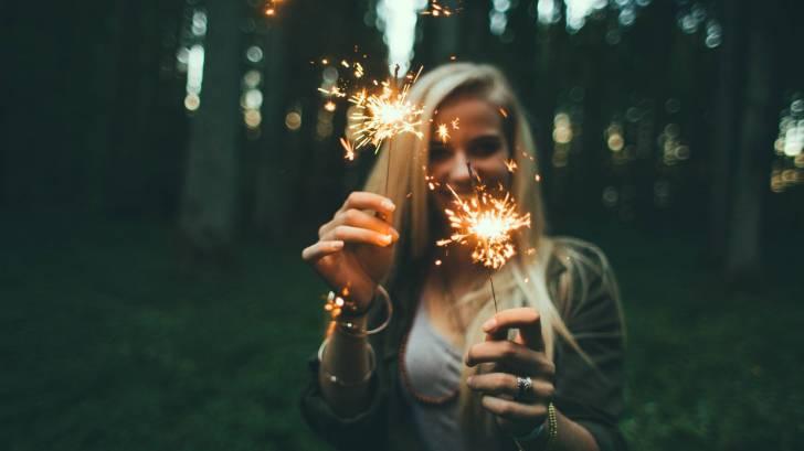 girl with sparklers celebrating