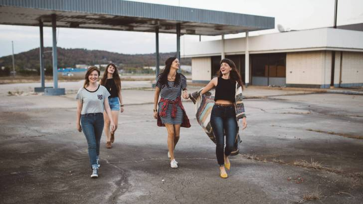 girls walking happy