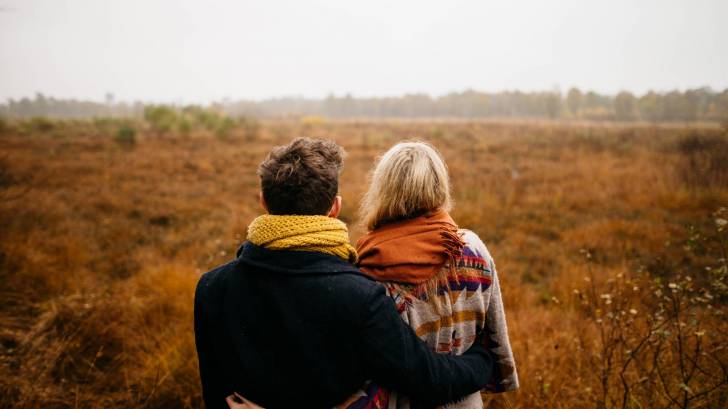 30 something couple in a field
