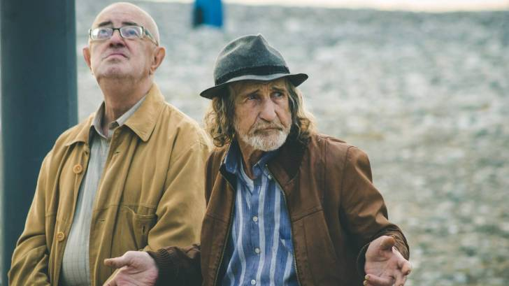 two older men sitting on a bench