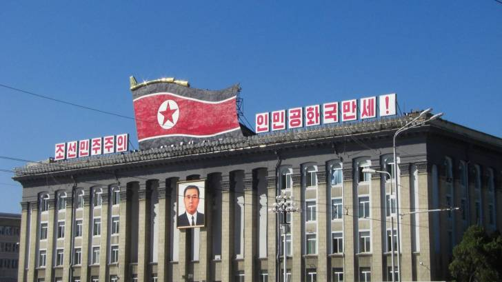 north korea building with flag