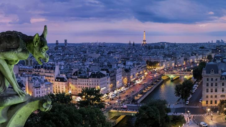 gargoyle looking down on the paris streets