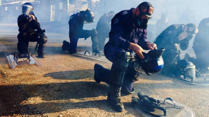 gas masks with police