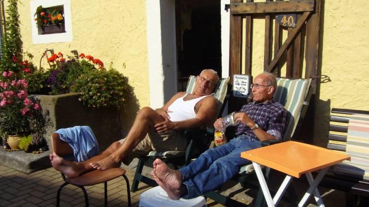 older men sitting in the sun