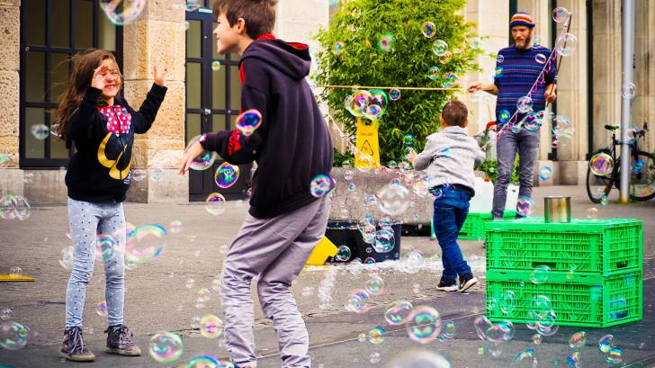 happy kids/teens playing with bubbles