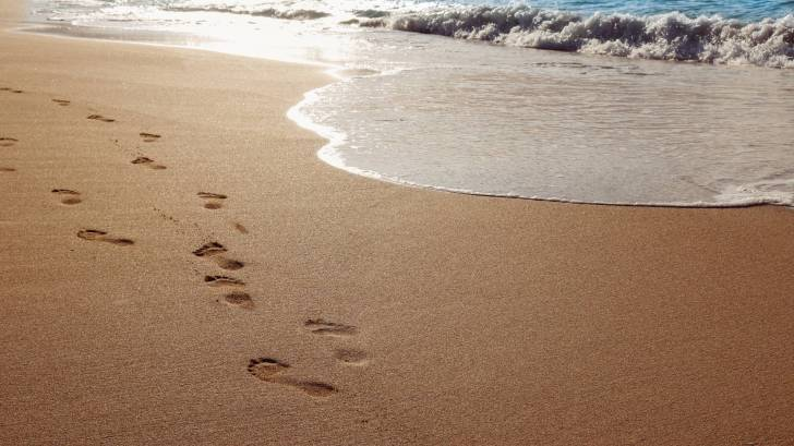 sandy beach with foot prints