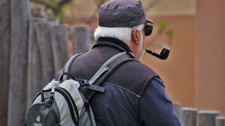elderly man smoking pipe