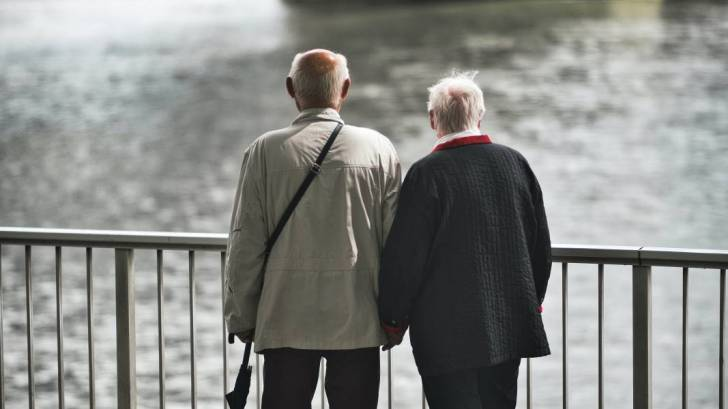 older couple looking at the water