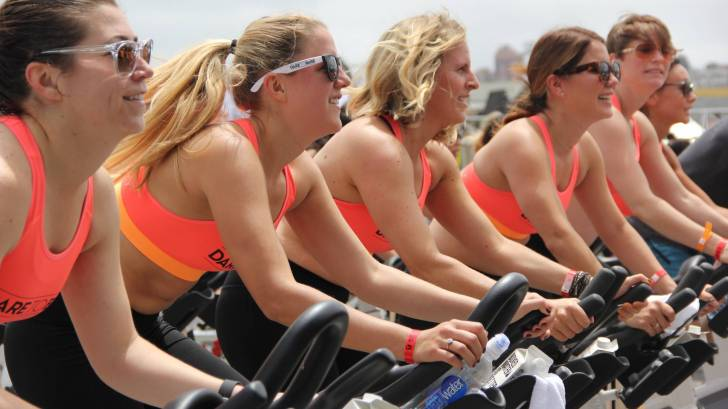women riding bikes together
