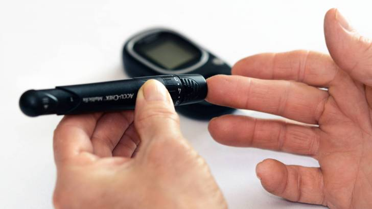 man testing his blood sugar level