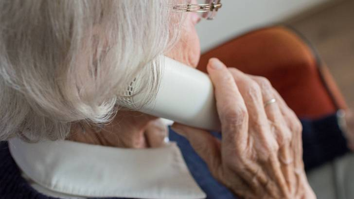 old woman on the phone with her pharmacist