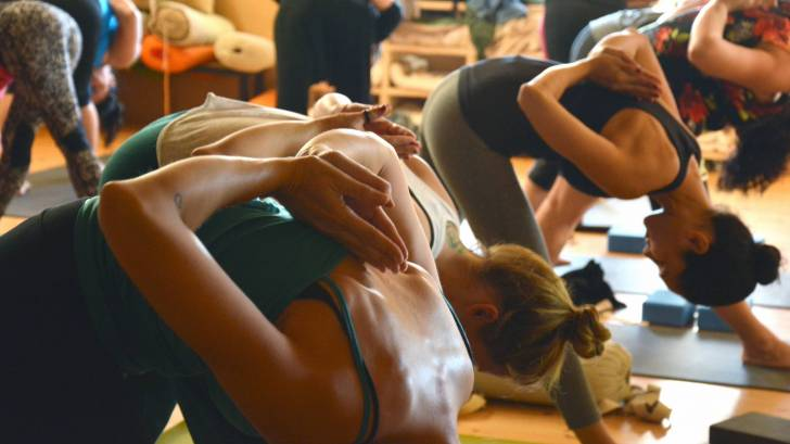Women in a yoga class, healthy living