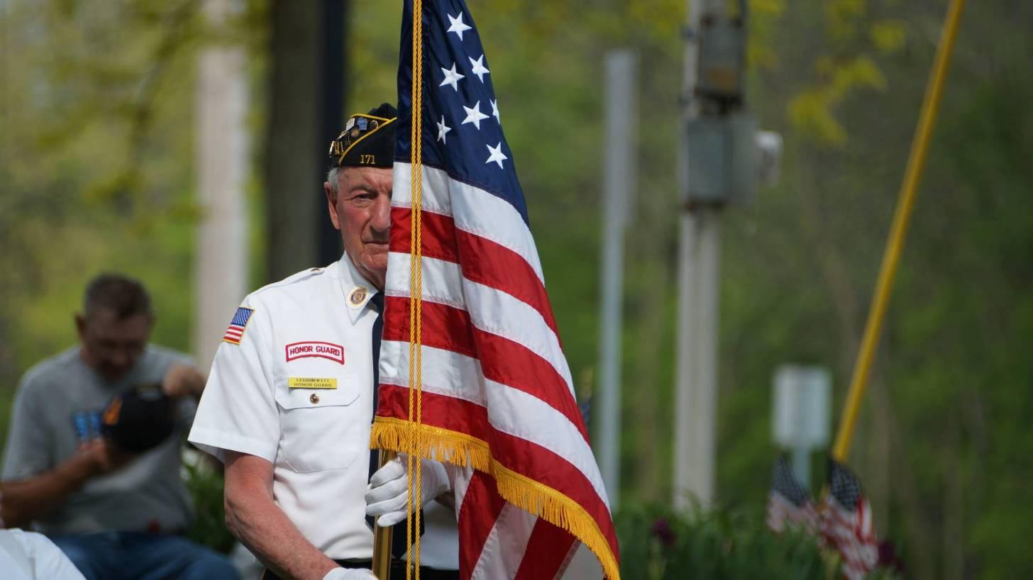 vet holding the american flag