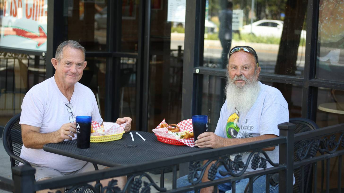 older men at a cafe outside