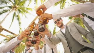 men cheering with beers