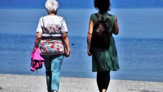 women walking on the beach talking