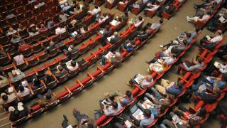 auditorium of people at a meeting