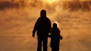 father and child in the fog