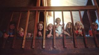 children looking thru a balcony