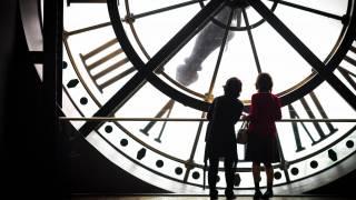 women standing in front of a huge clock
