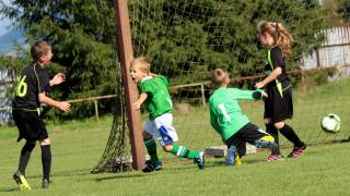 children playing soccer happy