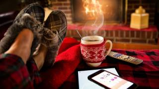 relaxing at home by the fire and cup of coffee