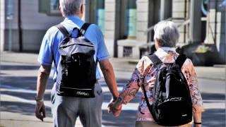 senior man and women walking holding hands