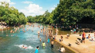 people hanging out at barton springs in austin