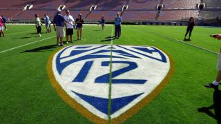 ucla rose bowl pac 12 symbol on the turf
