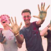 teens having fun with color paints