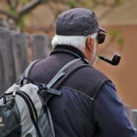 older man smoking a pipe
