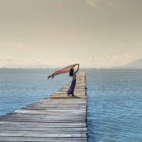 woman on a pier over water