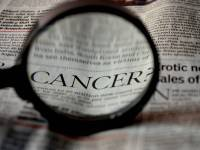 cancer word in a newspaper highlighted