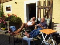 older men sitting in the sun